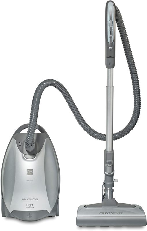 Canister vacuum cleaner with crossover nozzle